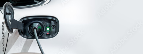 .White electric car charging with copy space, Technology electric vehicle concept