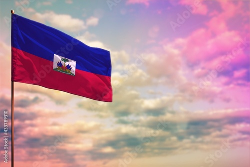 Obraz na plátně Fluttering Haiti flag mockup with the space for your content on colorful cloudy sky background