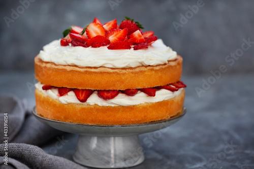 Valokuva Victoria`s sponge cake, delicious homemade vanilla cake decorated with whipped c