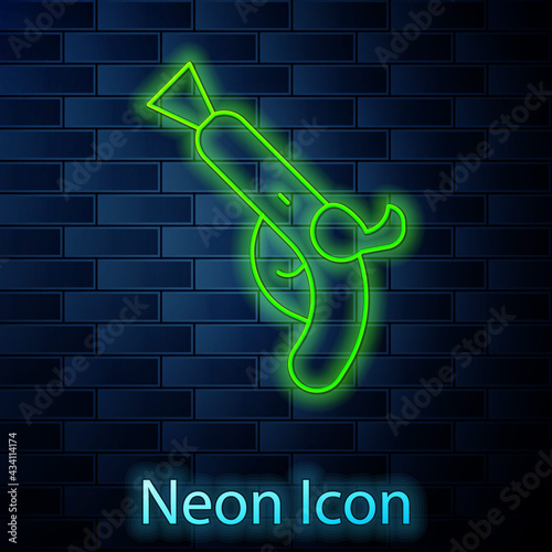 Fotografie, Obraz Glowing neon line Vintage pistols icon isolated on brick wall background