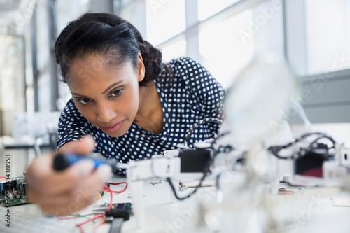 Fotografiet Focused engineer assembling robot