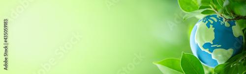 Photo World globe with nature green leaf
