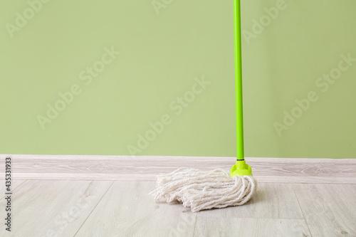 Floor mop near color wall Fototapeta