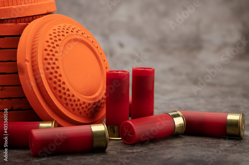 Clay disc flying targets and shotgun shells on texture background ,Clay Pigeon t Fotobehang