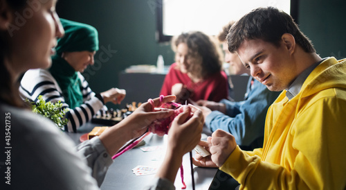 Fotografija Group of people playing cards and board games in community center, inclusivity of disabled person
