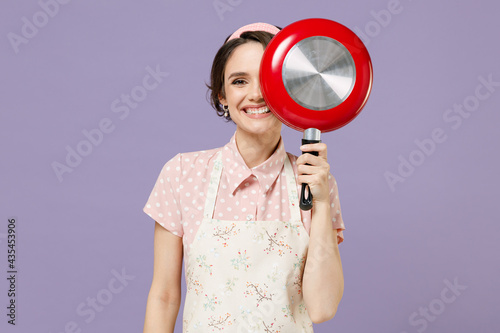 Fototapeta Young smiling happy cheerful housewife housekeeper chef cook baker woman in pink