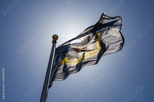 Obraz na plátně U. S. Navy Flag against Blue Sky and Sunlight