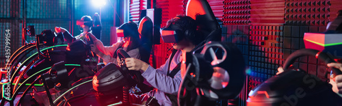 Canvas teenage friends in vr headsets gaming on car racing simulators, banner