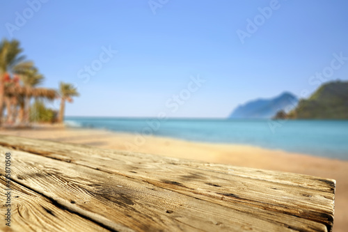 Leinwand Poster Wooden desk of free space for your decoration and summer landscpae of beach with