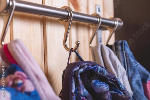 Obraz na płótnie Kid's cloth hanginig on metal hooks. Close-up.
