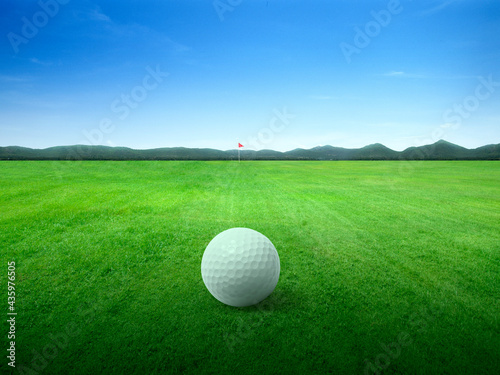 Slika na platnu Golf ball on green grass field and on green fairway with beautiful blue sky