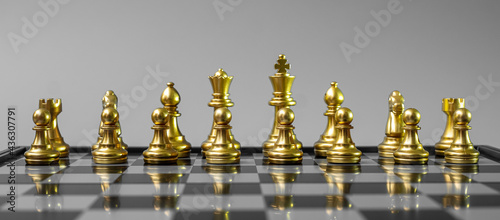 Canvas gold Chess figure team (King, Queen, Bishop, Knight, Rook and Pawn) on Chessboard against opponent during battle