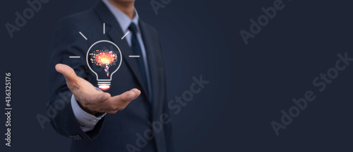 Businessman hand with brain represent of AI Artificial Intelligence, futuristic innovative technology concept. data mining, deep learning machine with circuit board