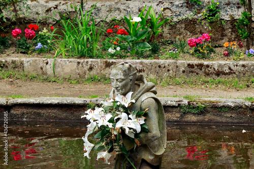 Fotografia, Obraz Statue of Saint Bruno of Cologne in the lake of penance in Serra San Bruno (Cala