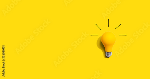 Fotografering Yellow light bulb