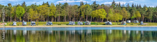 Fotografija Motorhome parking at a lake near Eersel in the Netherlands