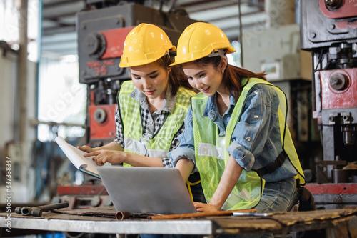 Fototapeta Engineer and workers Asian working using laptop computer