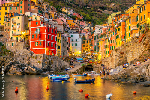 Riomaggiore,  Colorful cityscape on the mountains over Mediterranean sea in Cinque Terre Italy