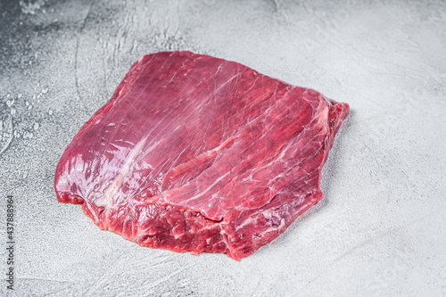 Raw flank or flap beef meat steak. White background. Top view Fototapete