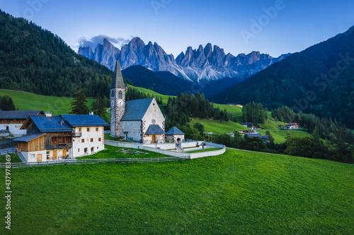 Fototapeta St Magdalena church in Val di Funes valley in evening dusk light, Dolomites, Italy