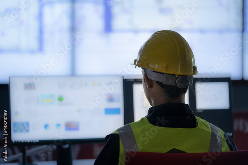 Valokuva Industrial Engineering works in front of monitoring screen in the production control center