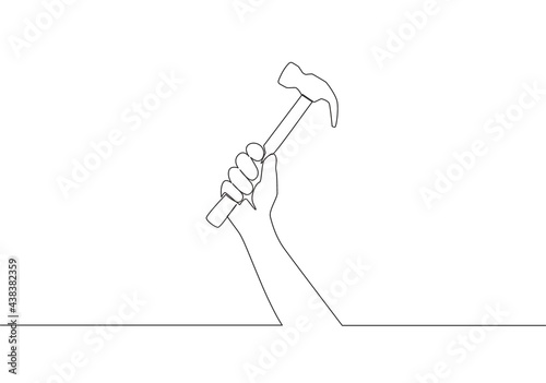 Fototapeta Single continuous line drawing of man holding hammer steel