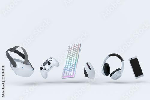 Flying gamer gears like mouse, keyboard, joystick, headset, VR on white Fototapet
