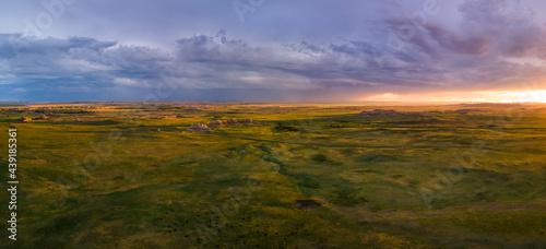 Fotografie, Obraz Dramatic sunset over the prairie Badlands National Park - South Dakota