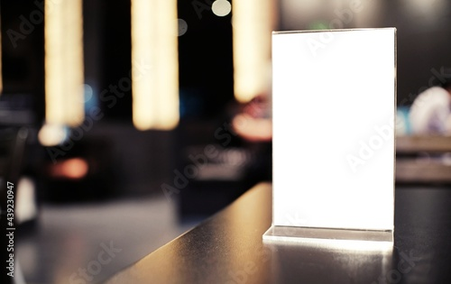 Menu frame standing on wood table in Bar restaurant cafe. space for text marketing promotion.