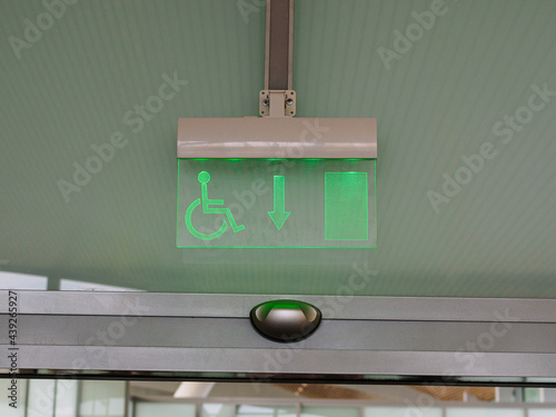 emergency exit sign for disabled people in a business center, airport Fototapet