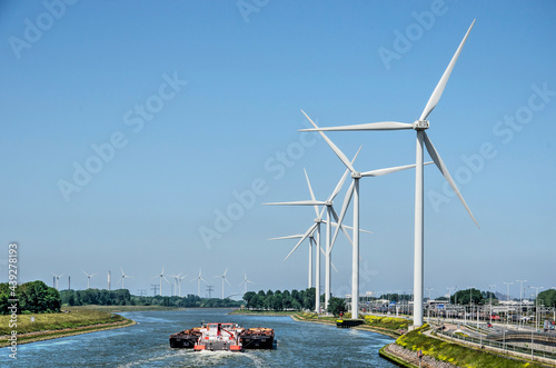 Wallpaper Mural Rotterdam, The Netherlands, June 12, 2021: cargo vessel on Hartel canal, lined w