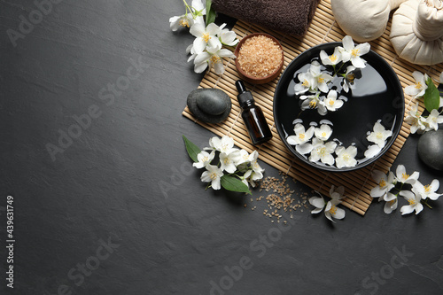 Canvas Print Beautiful spa composition with jasmine essential oil and fresh flowers on table, flat lay