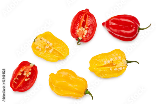 Leinwand Poster yellow and red habanero chili hot peppers isolated on white background