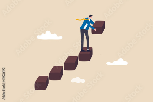 Obraz na plátně Build business success stairs, self development or career growth and job improvement, growing up or job promotion concept, businessman building staircase to progress ascending business growth