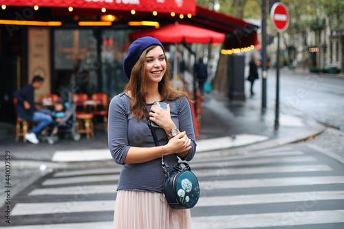 Fototapeta Beautiful girl walking in romantic paris