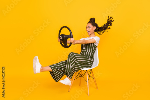 Tablou Canvas Full body photo of excited dark skin young woman sit chair hold steering wheel i