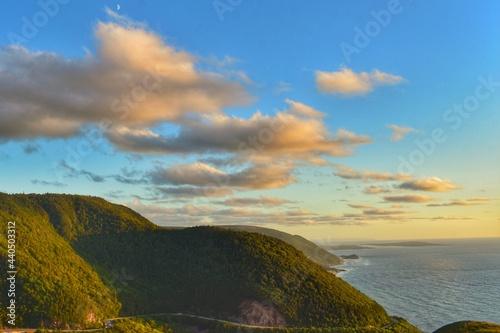 Fotografiet Green Hills Lit by Sunset on Cape Breton Island