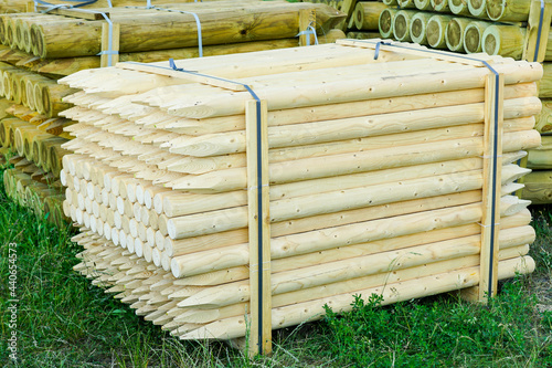 pallet with round natural wood stakes with a sharpened tip Fototapeta