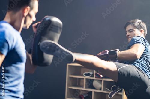 Caucasian Fitness trainer teach sportsman boxer doing boxing at gym Fototapete