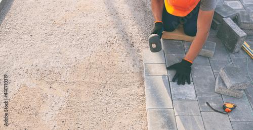 Wallpaper Mural Worker lining paving slabs path