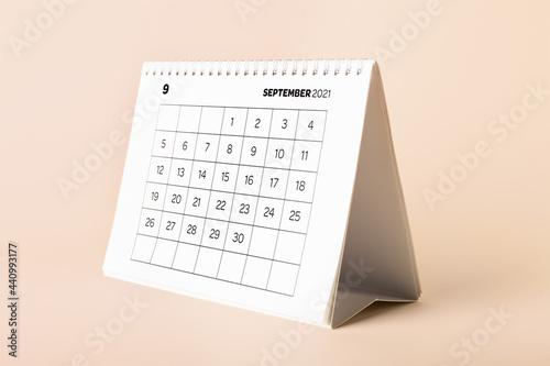 Fotografia, Obraz Flip calendar with page of September on color background