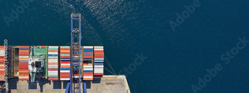 Canvas-taulu Aerial top down ultra wide photo of industrial container ship loading  - unloadi