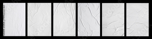 Photo white crumpled and creased glued paper poster set isolated on black background