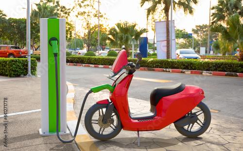 Obraz na plátne Generic electric scooter charging on street parking, Future EV car concept