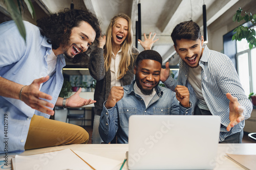 Happy overjoyed business team celebrate corporate victory