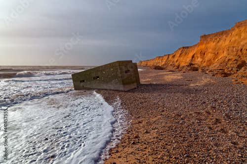 Valokuvatapetti ww2 pill box that has fallen in to the sea due to coastal erosion, Suffolk, England