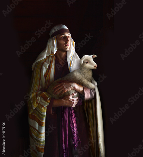 Stampa su Tela Shepherd hold a sheep in his arms