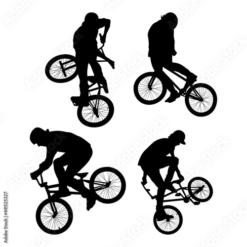Billede på lærred BMX freestyle bicyclist silhouettes in black on white background