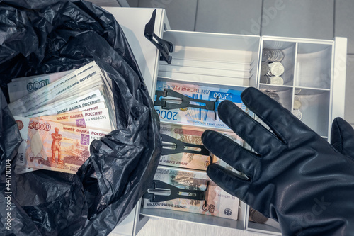 Stampa su Tela Robber's hand in black glove stealing cash rubles (Russian money) from cashbox a