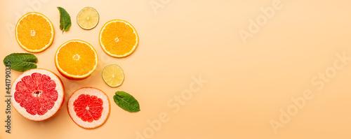 Photo summer background concept: sliced orange, grapefruit, lemon, lime, mint on orang